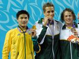 Chad Le Clos (centre) of South Africa took the gold medal and his compatriot Dylan Bosch won the bronze at the Youth Men's 200m Individual Medley. At left is silver medalist, Kenneth To of Australia.