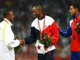 (L-R) Silver medalist Khotso Mokoena of South Africa, gold medalist Irving Jahir Saladino Aranda of Panama and bronze medalists Ibrahim Camejo of Cuba stand on the podium during the medal ceremony for the Men's Long Jump Final held at the National Stadium on Day 11 of the Beijing 2008 Olympic Games on August 19, 2008 in Beijing, China.