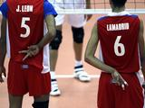 Alexis Lamadrid (R) and Juan Leon of Cuba gesture during the Boys Volleyball Preliminary match between Cuba and Iran. Cuba won by 3-1.