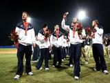 Players from the United States walk off the field after they received their bronze medals medals following Korea's 3-2 win against Cuba in the men's gold medal baseball game held at Wukesong Baseball Field on Day 15 of the Beijing 2008 Olympic Games on August 23, 2008 in Beijing, China.