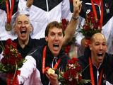 Ryan Millar (C) of the United States celebrates with Men's indoor volleyball head coach Hugh McCutcheon (L) and William Priddy after the Gold Medal volleyball match between the United States and Brazil held at the Capital Indoor Stadium during Day 16 of the Beijing 2008 Olympic Games on August 24, 2008 in Beijing, China.