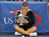 Samantha Stosur celebrates with the championship trophy after defeating Serena Williams at the 2011 US Open in New York City.