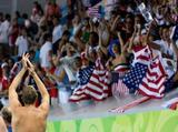 Fans cheer for the United States after they defeated Serbia in the men's semifinal game of the water polo event at the Yingdong Natatorium.
