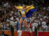 Nataliia Dobrynska of Ukraine celebrates winning the Women's Heptathlon 800m Final and the gold medal at the National Stadium on Day 8 of the Beijing 2008 Olympic Games on August 16, 2008 in Beijing, China. Nataliia Dobrynska of Ukraine finished the event in first place with a score of 6733.