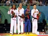 (L-R) Deborah Gravenstijn of The Netherlands, Giulia Quintavalle of Italy, Ketleyn Quadros of Brazil, and Yan Xu of China celebrate their medals in the judo event.
