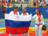 (L-R) Silver medalist Dinara Safina of Russia, gold medalist Elena Dementieva of Russia and bronze medalist Vera Zvonareva celebrate after receiving their medals from the Women's Singles event held at the Olympic Green Tennis Center.
