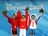 (L-R) Silver medallist Sibel Ozkan of Turkey, gold medallist Chen Xiexia of China and bronze medallist Chen Wei-Ling of Chinese Taipei stand on the podium during the medal ceremony for the Women's 48kg Group A Weightlifting event held at the Beijing University of Aeronautics and Astronautics Gymnasium on Day 1 of the Beijing 2008 Olympic Games on August 9, 2008 in Beijing, China.