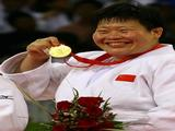 Tong Wen of China poses with the gold medal after defeating Maki Tsukada of Japan in the women's 78 kg judo event.