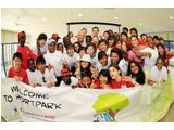Students at the Singapore 2010 Friendship Camp gather with Olympian Michael Klim.