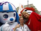 German athlete Dirk Nowitzki poses with a young athlete during a welcoming ceremony for the Olympic Flame in Berlin.