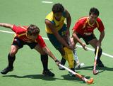 Desmond Abbott  moves the ball upfield under pressure from Spain during the 2011 Men's Champions Trophy in Auckland, New Zealand.