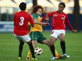 Mustafe Amini is tackled by Yasser Yahyam Al Shaibani of Yemen during the first 2012 London Olympic Games Asian Qualifier match between the Australian Olyroos and Yemen.