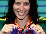 Alicia Coutts poses with her five gold medals at the Delhi 2010 Commonwealth Games. Alicia's medals came from the 100m butterfly, 100m freestyle, 200m IM, 4x100m freestyle relay and the 4x100m medley relay