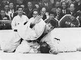 Tokyo 1964: Anton Geesink of the Netherlands holds down Akio Kaminaga of Japan shortly before winning the open judo category, much to the disappointment of the host country. It was the first time judo has been a part of the Olympic program.