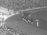 Berlin 1936: The Australian team walk behind the Australian flag carried by Edgar Gray at the Opening Ceremony.