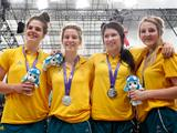 Players from Australia's basketball team pose for photos after receiving their girls' basketball silver.