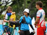 Singapore's Vanessa Loh (second from right in blue) and teammate Spain's Carlos Rivas (right) crashed out in the archery Mixed Teams' 1/8 elimination round of the Singapore 2010 Youth Olympic Games (YOG) played at the Kallang Field in Singapore, Aug 19 2010. Loh and Rivas were defeated 4 sets to 6 by Australia's Benjamin Nott and Solvenia's Brina Bozic (background).