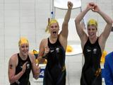(L-R) Jessicah Schipper, Leisel Jones and Emily Seebohm of Australia cheer on their teammate Lisbeth Trickett (not pictured) during the Women's 4x100m Medley Relay final.