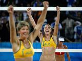 Nat Cook (L) and Tamsin Hinchley celebrate after defeating Andrezza Chagas and Cristine Santanna of Georgia during the beach volleyball event at the Beijing 2008 Olympic Games. Cook and Hinchley finished the Games in 5th place.