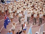 Diver Jenny Donnett leads the Australian team during the Parade of Nations at the Opening Ceremony.
