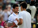 Novak Djokovic of Serbia (L) shakes hands with Bernard Tomic after winning his quarterfinal round match during the Wimbledon Lawn Tennis Championships at the All England Lawn Tennis and Croquet Club.