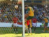 Jason Hoffman scores his teams first goal during the first 2012 London Olympic Games Asian Qualifier match between the Australian Olyroos and Yemen at Bluetongue Stadium.