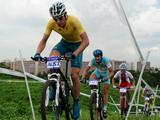 (left to right) Australia's Michael Baker, Kazhakstan's Vadim Galeyev, Poland's Bartlomiej Wawak and Hungary's Peter Fenyvesi cycle on day one of the Cycling Junior Men's Cross Country.