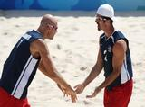 (L-R) Phil Dalhausser and Todd Rogers of the United States react during their beach volleyball match against Jan Schnider and Martin Laciga of Switzerland at the Chaoyang Park Beach Volleyball Ground on Day 8 of the Beijing 2008 Olympic Games on August 16, 2008 in Beijing, China.