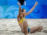 Tamsin Hinchley celebrates a point against Andrezza Chagas and Cristine Santanna of Georgia during the beach volleyball event at the Beijing 2008 Olympic Games.