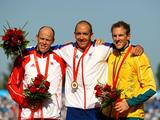 (L-R) Silver medalist Eirik Veraas Larsen of Norway,gold medalist Tim Brabants of Great Britain and bronze medalist Ken Wallace receive their medals following the men's flatwater kayak single (K1) 1000m Men Final at the Beijing 2008 Olympic Games.