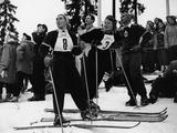 Oslo 1952: Close competitors - Austrian skier Trude Beiser-Jochum (#8, left) and German skier Anne Marie Buchner (#3) watch one of their competetors in the women's slalom event at the Winter Olympics. Buchner eventually took the bronze medal in the event, and in the women's downhill event, she won the silver, finishing nine-tenths of a second behind Beiser-Jochum, who came first.