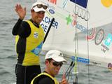 Malcolm Page and Mathew Belcher celebrate winning Gold after the 470 Medal race on the Centre Course during day nine of the 2011 ISAF Sailing World Championships on December 11, 2011 in Perth, Australia.