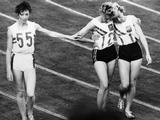 Tokyo 1964:  Great Britain's Ann Packer (left) silver medallist acknowledges defeat at the hands of Australia's Betty Cuthbert (centre), winner of the 400m. Bronze medallist Judith Amooreis on the right.