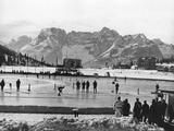 Cortina d'Ampezzo 1956: A general view of the Olympic skating rink, as Boris Shilkov of Soviet Russia crosses the finishing line to win the 5,000m speed skating event.
