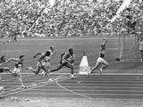 Munich 1972: Valeriy Borzov of the Soviet Union crosses the finish line with his arms raised in victory after winning the men's 100m final. Coming behind in second place is American Robert Taylor and in third place is Lennox Miller of Jamaica. Borzov was the first Russian to win an Olympic men's 100m gold medal.