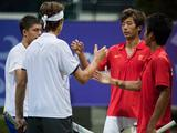 (from right to left) China's Ouyang Bowen and Wang Chuhan shake hands with Czech Republic's Jiri Vesely and Great Britain's Oliver Golding. Vesely and Golding won the match 3-6, 6-3, 6-10.