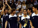 Andres Marcelo Nocioni #13 of Argentina films his teammates during the medal ceremony where Argentina received the bronze medal in the men's basketball final during Day 16 of the Beijing 2008 Olympic Games at the Beijing Olympic Basketball Gymnasium on August 24, 2008 in Beijing, China.