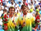 Ricardo Santos and Emanuel Rego of Brazil stand on the podium with their bronze medals in beach volleyball at the Chaoyang Park Beach Volleyball Ground.