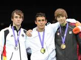Silver medalist Nikolaus Bodoczi of Germany, gold medalist Marco Fichera of Italy, bronze medalists Alexandre Lyssov of Canada (L to R) stand on the podium during the awarding ceremony of Cadet Male Individual Epee of fencing.