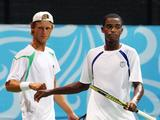 Darian King (right) of Barbados and teammate Pavel Krainik of Canada pauses between games in their first set