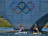 Athletes at the Australian Youth Olympic Festival paddle past the Olympic rings at the AYOF canoe/kayak sprint venue in Penrith.