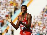 Carl Lewis of the USA acknowldges the crowd after his 8.54m performance to win the long jump.Australian Gary Honey was second with 8.24m. Lewis won the 100m, 200m, 4x100m and long jump at the Games to equal the great Jesse Owens with four gold medals in a single Olympics.