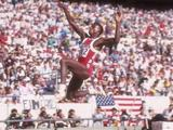 Carl Lewis of the United States flies through the air during the long jump and went on to win the event.