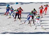 Charlotte Kalla (R) of Sweden leads the pack during the cross country 