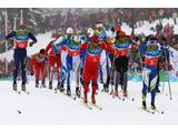 Competitors ski in the Classic style on the first leg during the cross 