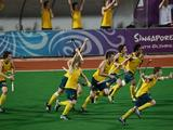 Australia's hockey team celebrates after Luke Noblett (not in picture) converts a penalty shot in the 67th minute in the gold medal boys' hockey match
