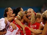 Maria Stepanova #11 (C) of Russia celebrates with her teammates after the defeated Spain in their quaterfinal women's basketball match.