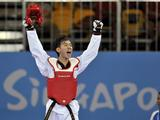 Tan Jia Jun Daryl of Singapore celebrates his victory after defeating Shein Naing Dwe Shein (MYA) of Myanmar during men's -55kg Taekwondo quarterfinal.