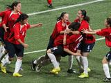Chile's players celebrate after scoring a goal in the Trinidad & Tobago versus Chile girl's preliminary football match. Chile beat Trinidah & Tobago 1-0.
