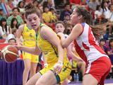 Chile's Garcia Katalina (right) challenges Australia's Rosemary Fandljevic in a preliminary girls' basketball match. Australia beat Chile 12-4.